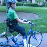 Figure 2: client riding the custom tricycle